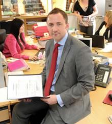 Headshot of Derek Petterson, CEO of Meldrum Construction