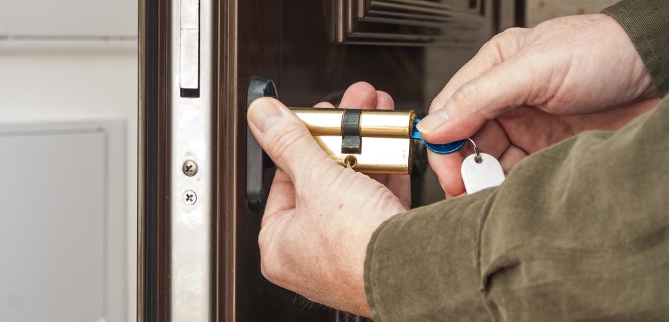 A locksmith opening a jammed door