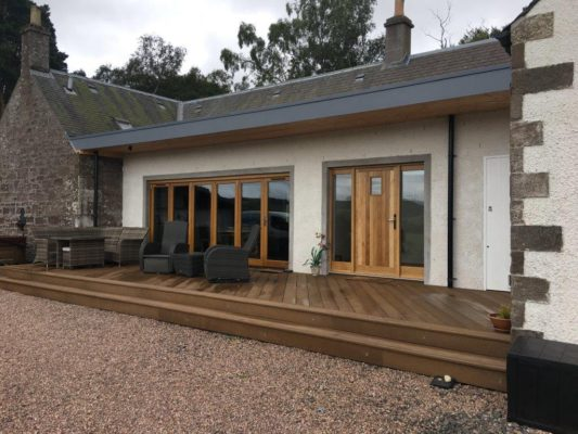 A flat roof extension in Abernyte, Perthshire, with new decking and bi-fold doors