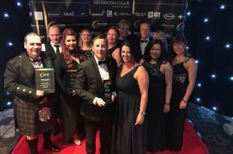 McLeod Glaziers pictured with the Courier Business award for family business of the year